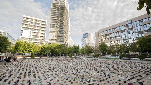 4,500 paires de chaussures posées devant le siège du Conseil de l'UE à Bruxelles - Sputnik France