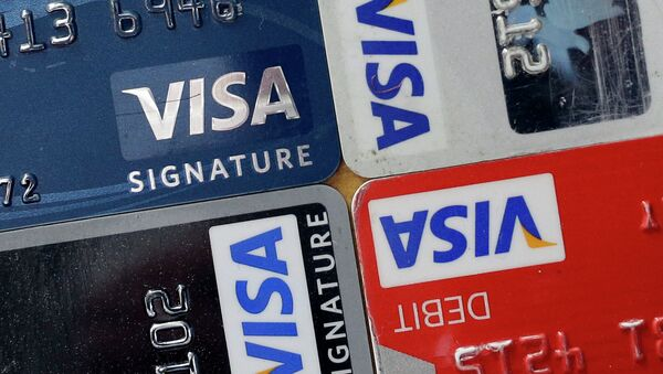 In this April 25, 2013 file photo, credit and debit cards are displayed for a photographer in Baltimore. Visa Inc. reports quarterly earnings on Thursday, April 24, 2014 - Sputnik France