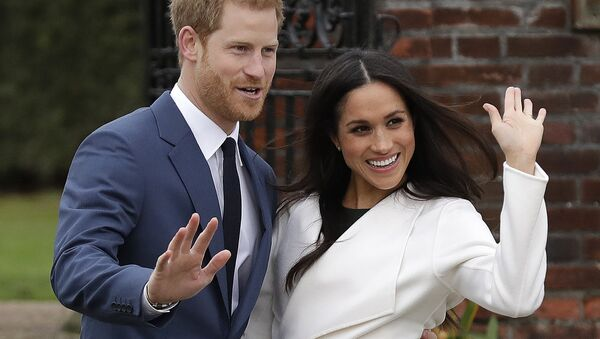 Britain's Prince Harry and his fiancee Meghan Markle pose for photographers during a photocall in the grounds of Kensington Palace in London, Monday Nov. 27, 2017 - Sputnik France