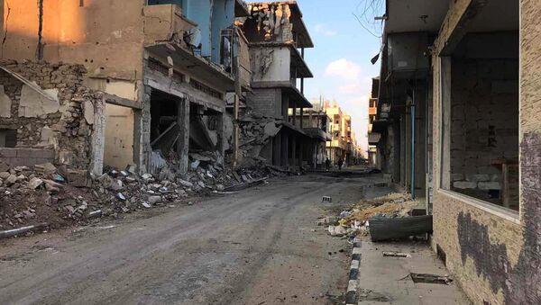 Des bâtiments détruits dans la ville de Homs (archive photo) - Sputnik France