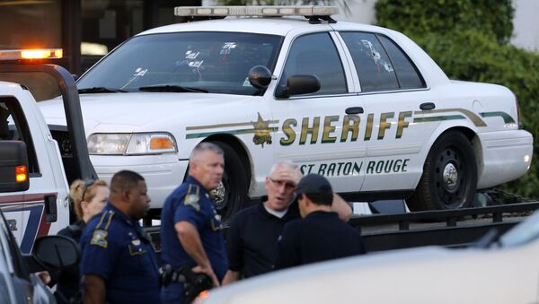 An East Baton Rouge Sheriff vehicle is seen with bullet holes in its windows near the scene where police officers were shot, in Baton Rouge, Louisiana, U.S. July 17, 2016. - Sputnik France