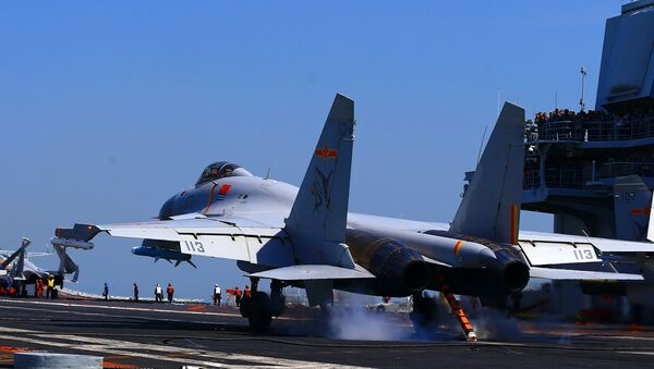 This photo taken on April 24, 2018 shows a J15 fighter jet landing on China's sole operational aircraft carrier, the Liaoning, during a drill at sea - Sputnik France