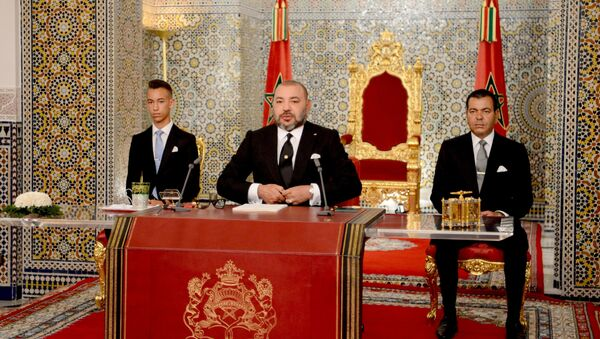 In this photo provided by the Moroccan Royal Palace, King Mohammed VI, foreground, is flanked by his brother Prince Moulay Rachid, right, and Crown Prince Moulay Hassan, during a speech to the nation on the occasion of the 18th anniversary of ascending to the throne, at the royal palace in Tetouan, northern Morocco, on Saturday July 29, 2017. - Sputnik France