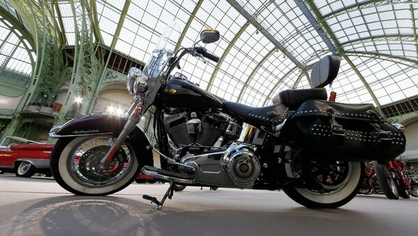A Harley-Davidson motorcycle blessed with the signature of Emeritus Pope Benedict XVI, and later received by Pope Francis, is displayed ahead of the Bonhams' Les Grandes Marques du Monde vintage motor cars and motorcycles auction at the Grand Palais exhibition hall as part of the Retromobile vintage car show in Paris February 4, 2015 - Sputnik France