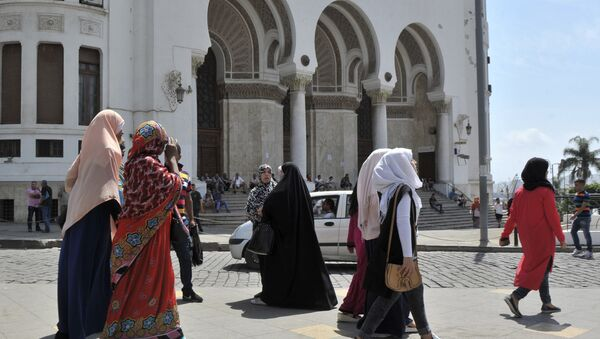 Veiled women walk in central Algiers, Wednesday Aug. 10, 2016. Mosques are going up, women are covering up and bars, restaurants and shops selling alcoholic beverages are shutting down in a changing Algeria where, slowly but surely, Muslim fundamentalists are gaining ground. - Sputnik France