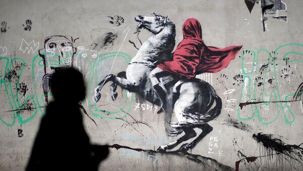 A recent artwork believed to be attributed to British activist-artist Banksy is pictured in Paris, France, June 25, 2018. - Sputnik France