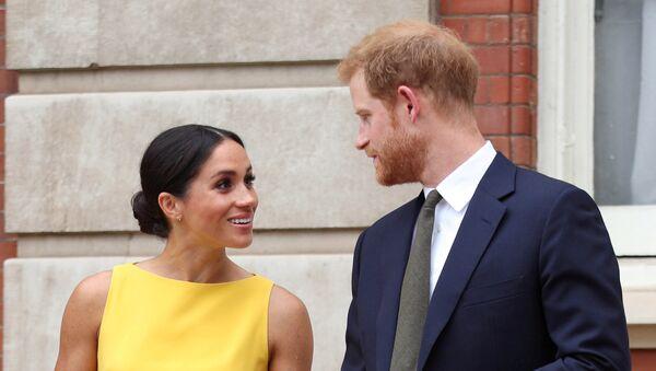 Le prince Harry et son épouse Meghan - Sputnik France