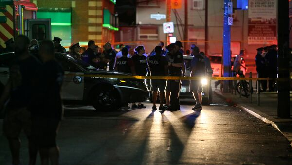 Police are seen near the scene of a mass shooting in Toronto, Canada, July 22, 2018 - Sputnik France