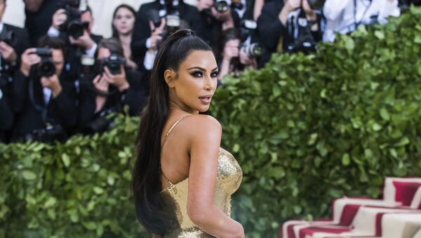 Kim Kardashian attends The Metropolitan Museum of Art's Costume Institute benefit gala celebrating the opening of the Heavenly Bodies: Fashion and the Catholic Imagination exhibition on Monday, May 7, 2018, in New York - Sputnik France