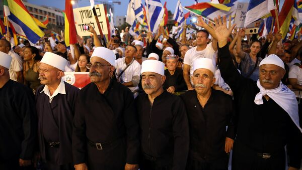 Leaders from the Druze minority together with others take part in a rally to protest against Jewish nation-state law in Rabin square in Tel Aviv, Israel, August 4, 2018. - Sputnik France