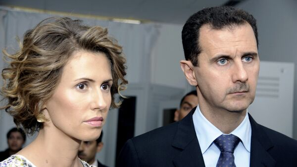 Präsident Baschar al-Assad mit seiner Gattin Asma (Archivbild) - Sputnik France