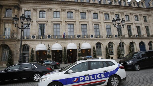 A police car drives past the Ritz hotel in Paris, Thursday, Jan. 11, 2018. Paris police have recovered some jewels stolen from the Ritz Hotel in a multimillion-euro robbery attempt, but are still searching Thursday for two thieves and the rest of the missing luxury merchandise. (AP Photo/Michel Euler) - Sputnik France