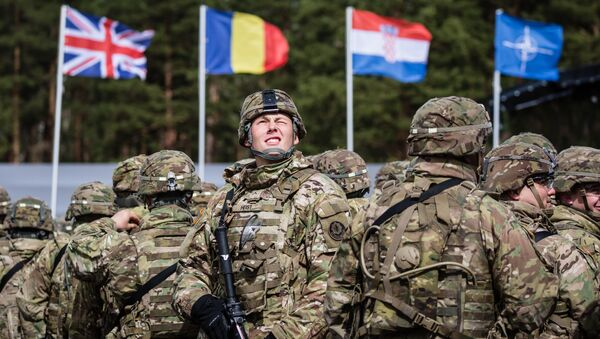 US soldiers are pictured prior the beginning of the official welcoming ceremony of NATO troops in Orzysz, Poland, on April 13, 2017. - Sputnik France
