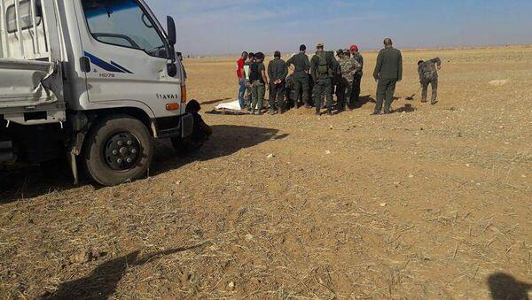 Des charniers de civils découverts près d'Abou-Douhour en Syrie - Sputnik France