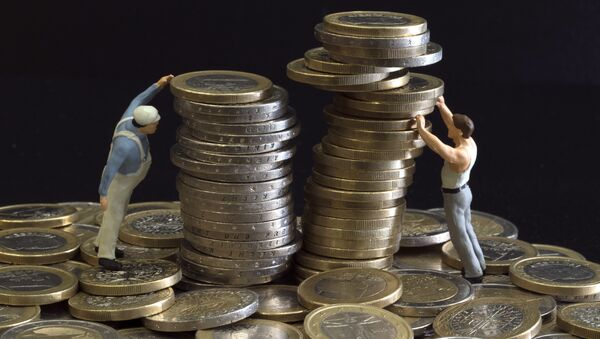 Picture taken on July 26, 2012 in Paris shows an illustration made with figurines and euro coins - Sputnik France