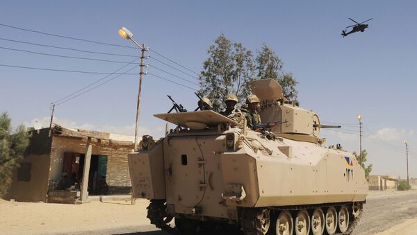 File photo, Egyptian Army soldiers patrol in an armored vehicle backed by a helicopter gunship during a sweep through villages in Sheikh Zuweyid, north Sinai, Egypt - Sputnik France