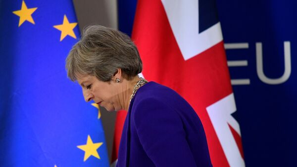 FILE PHOTO: Britain's Prime Minister Theresa May leaves a news conference at the European Union leaders summit in Brussels, Belgium October 18, 2018. REUTERS/Toby Melville/File Photo - Sputnik France