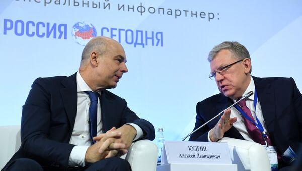 Anton Silouanov et Alexeï Koudrine, l'ancien et l'actuel Ministres des Finances - Sputnik France