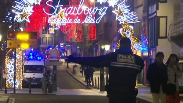 In this image made from video, emergency services arrive on the scene of a Christmas market in Strasbourg, France, Tuesday, Dec. 11, 2018 - Sputnik France