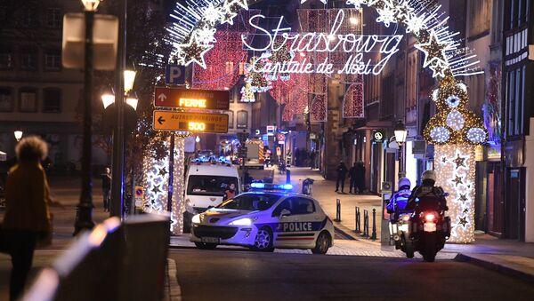 A police car drives in the streets of Strasbourg, eastern France, after a shooting breakout, on December 11, 2018 - Sputnik France