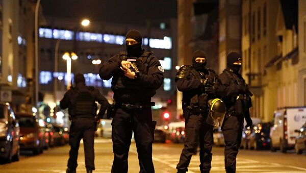 French special police forces secure an area during a police operation where the suspected gunman, Cherif Chekatt, who killed three people at a Christmas market in Strasbourg, was killed, in the Meinau district in Strasbourg, France, December 13, 2018. - Sputnik France