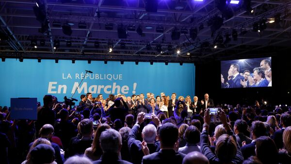 A close ally of French President Emmanuel Macron, Christophe Castaner, center, stands on the scene with his colleagues after being elected delegate general of French president's new centrist party, La Republique en Marche (The Republic on the Move, LREM), during a party convention in Chassieu, near Lyon, central France, Saturday, Nov. 18, 2017.  - Sputnik France