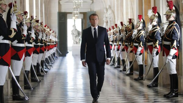 French President Emmanuel Macron walks through the Galerie des Bustes (Busts Gallery) to access the Versailles Palace's hemicycle to address both the upper and lower houses of the French parliament at a special session in Versailles, near Paris, Monday, July 9, 2018. - Sputnik France