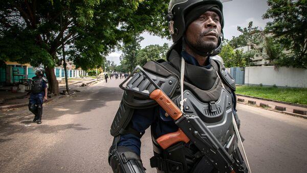 Policier congolais d'une brigade anti-émeute après les élections présidentielles en RDC - Sputnik France