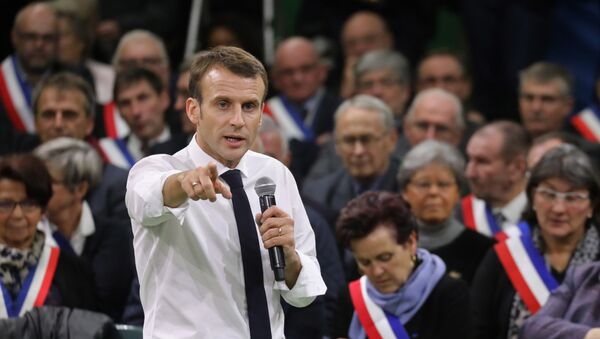 French President Emmanuel Macron (L) gestures as he speaks during meeting gathering some 600 mayors who will relay the concerns aired by residents in their towns and villages in the Normandy city of Grand Bourgtheroulde on January 15, 2019, as part of the official launch of the great national debate, a central plank of French President Emmanuel Macron bid to turn around his embattled presidency since the yellow vest (gilet jaune) movement protests. The meeting sounds the start of two months of public consultations in towns and villages across the country on four main themes: taxation; France's transition to a low-carbon economy; democracy and citizenship, and the functioning of the state and public services. - Sputnik France