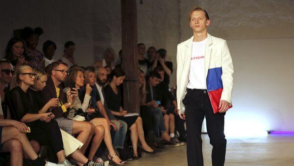 A model wears a creation for Gosha Rubchinskiy's Men's spring-summer 2015 fashion collection presented in Paris, France, Wednesday, June 25, 2014 - Sputnik France