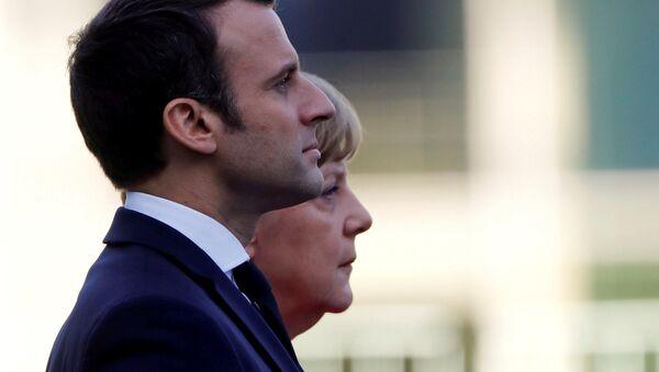 Frankreichs Präsident Emmanuel Macron und Deutschlands Bundeskanzlerin Angela Merkel - Sputnik France