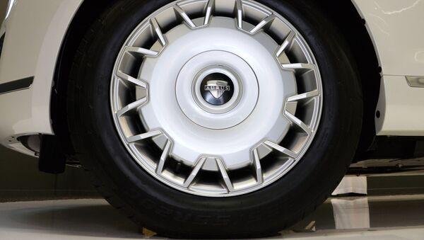 Колесо автомобиля Aurus, представленного на международной выставке вооружений IDEX-2019 в Абу-Даби - Sputnik France