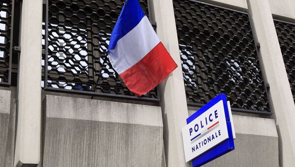 A French flag and a board indicating the police station of Vincennes, a southeastern Paris suburb, are pictured on March 5, 2012. - Sputnik France
