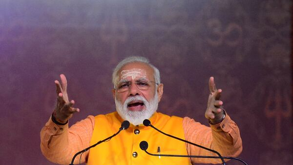 Indian Prime Minister Narendra Modi speaks during the Swachh Kumbh Swachh Aabhaar event organized by Ministry of Drinking Water & Sanitation at Ganga pandal during the Kumbh Mela festival in Allahabad on February 24, 2019 - Sputnik France