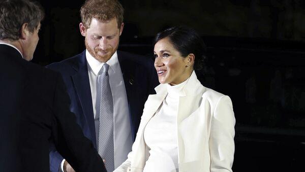 Meghan Markle et le prince Harry - Sputnik France