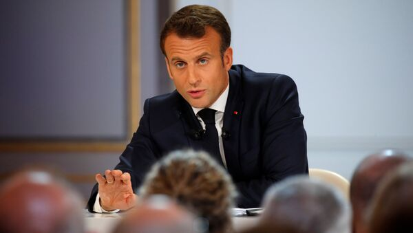 French President Emmanuel Macron speaks during a news conference to unveil his policy response to the yellow vests protest, at the Elysee Palace in Paris - Sputnik France