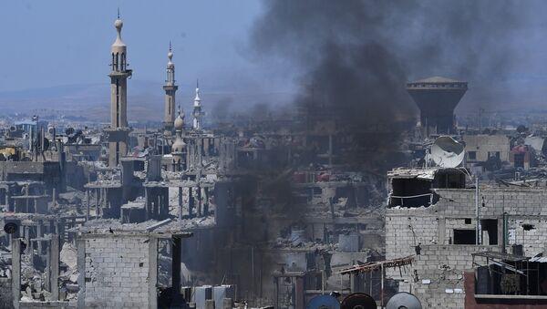 Assaut des positions de Daech* dans la zone de l'ancien camp de réfugiés palestiniens Yarmouk dans la banlieue sud de Damas - Sputnik France