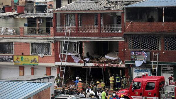 Firemen work following an explosion in a house where was a powder factory, in Bogota - Sputnik France