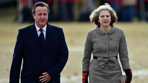 Britain's Prime Minister David Cameron (L) adn British Home Secretary Theresa May (R) - Sputnik France