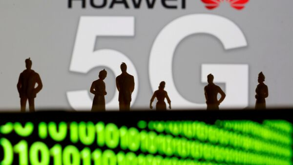 Small toy figures are seen in front of a displayed Huawei and 5G network logo in this illustration picture, March 30, 2019 - Sputnik France