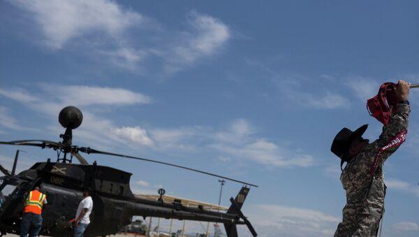 Un hélicoptère militaire léger et polyvalent OH-58 Kiowa - Sputnik France