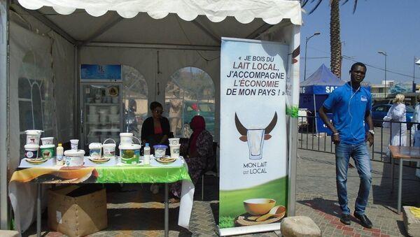 Un stand d'exposition-vente à Dakar, lors de la célébration de la Journée mondiale du lait, le 1er juin 2019. - Sputnik France