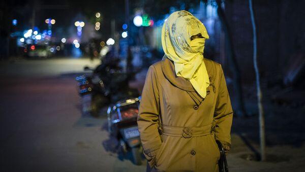 Femme ouïgoure en Chine - Sputnik France