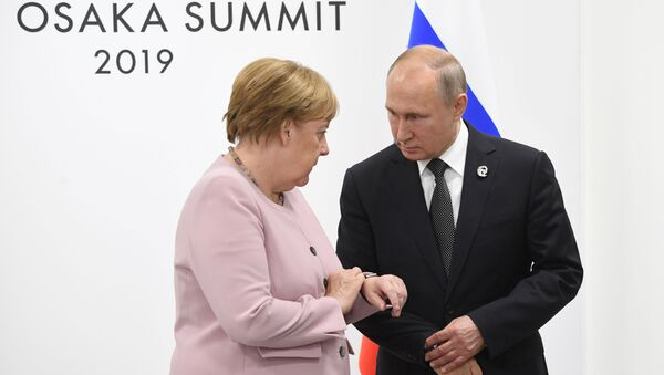 Angela Merkel et Vladimir Poutine à Osaka  - Sputnik France