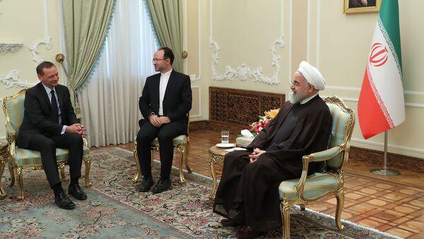 Hassan Rouhani (à droite) et Emmanuel Bonne - Sputnik France