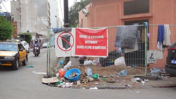 Un dépôt sauvage d'ordures dans le quartier du Plateau, à Dakar, en juillet 2019. - Sputnik France