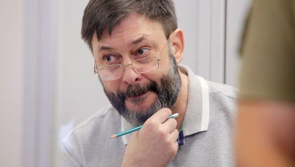 Le rédacteur en chef du portail RIA Novosti Ukraine, Kirill Vychinski, lors d'une séance de la cour d'appel de Kiev (28 août 2019) - Sputnik France