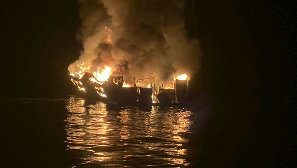 In this photo provided by the Santa Barbara County Fire Department, a dive boat is engulfed in flames after a deadly fire broke out aboard the commercial scuba diving vessel off the Southern California Coast, Monday morning, Sept. 2, 2019 - Sputnik France