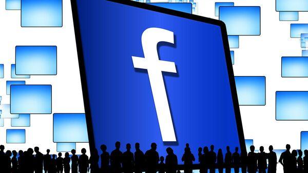 Un logo de Facebook y siluetas de personas - Sputnik France