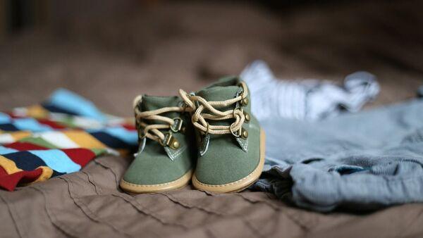 Chaussures d'enfant (image d'illustration) - Sputnik France